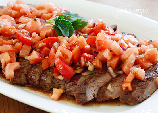 Grilled Flank Steak with tomato garnish. Photo by skinnytaste.com