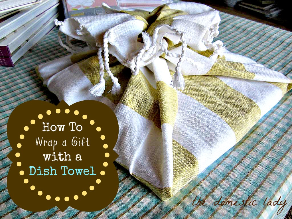 Tea towels are not only useful for drying dishes, but they make great easy gift wrap that you can reuse. You can find inexpensive tea towels that cost just as much as a gift bag or wrapping paper. A great time to stock up on Holiday printed towels is after Christmas when they are on clearance.