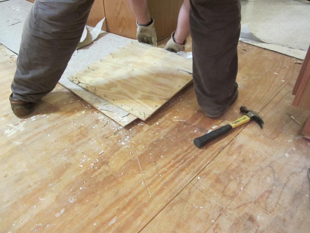 Home improvement removing vinyl flooring q tip cleaning for Removing vinyl flooring