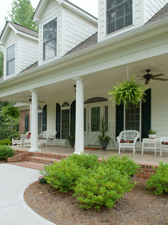 lovely-country-home-design-using-brick-front-porch-steps-and-concrete-walkway